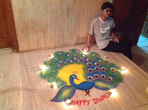 Happy Diwali Peacock Rangoli by Chidanand Patel