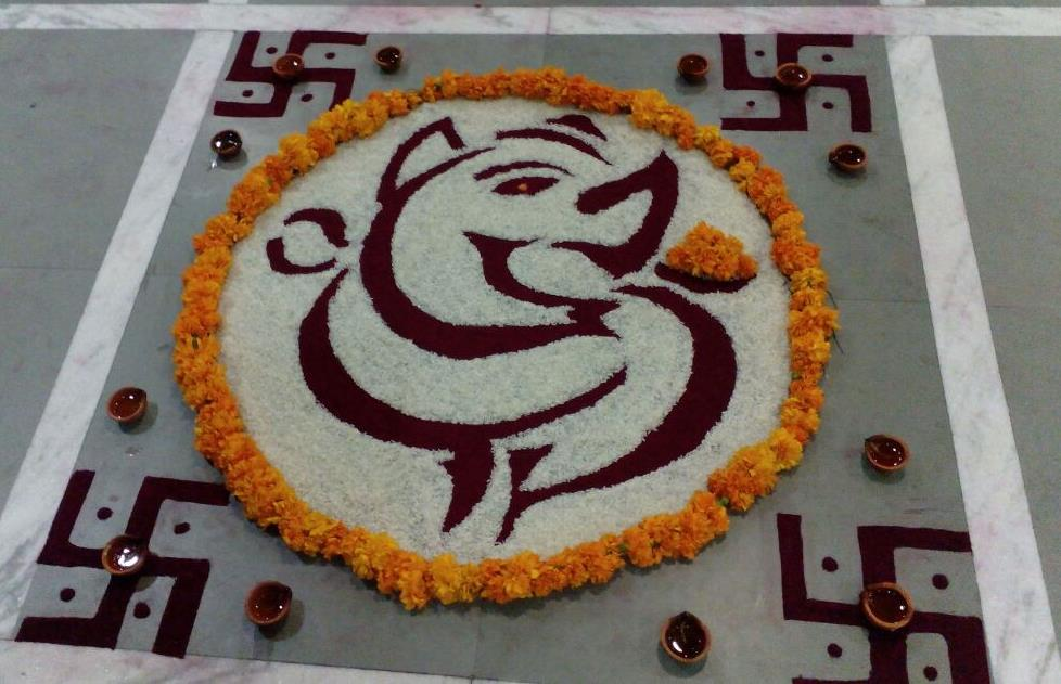 Riceand flowers Rangoli by Unknown