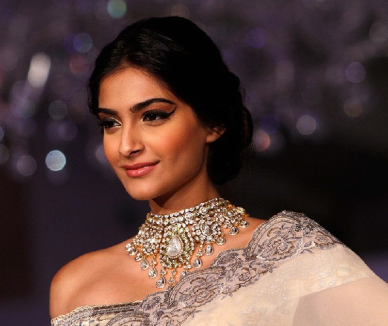 Sonam Kapoor winked Eye Liner and off shoulder Saree Blouse Style .