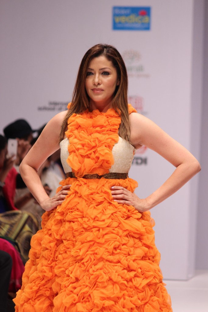 Actress Aditi Gowitrikar walked the ramp for Designer Megha Jain